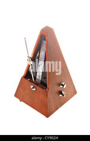 Vertical shot of a vintage metronome isolated on white - Stock Photo