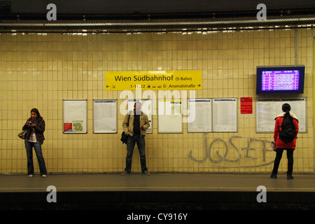 Passengers waiting on the S-Bahn platform of the at Wien Sudbahnhof train station, Vienna, Austria. - Stock Photo