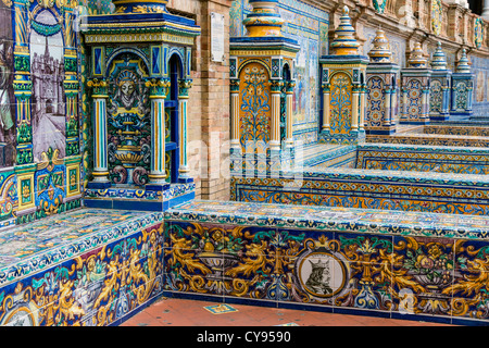 Detail of the tiled spanish provinces alcoves along the walls of the Plaza de España, Seville, Andalusia, Spain - Stock Photo