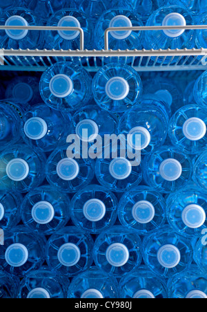 BOTTLED WATER IN A DRINKS DISPENSER AT AN AIRPORT - Stock Photo