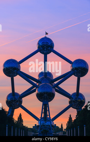 The Atomium in Brussels, build for the world expo in 1958 glowing in light after sunset. - Stock Photo