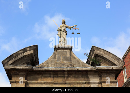 Statue of Lady Justice holding scales above an entrance gate in Dublin castle. Dublin, Republic of Ireland, Eire. - Stock Photo