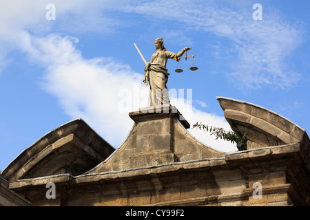 Dublin, Republic of Ireland, Eire. Statue of Lady Justice holding scales above an entrance gate in Dublin castle - Stock Photo
