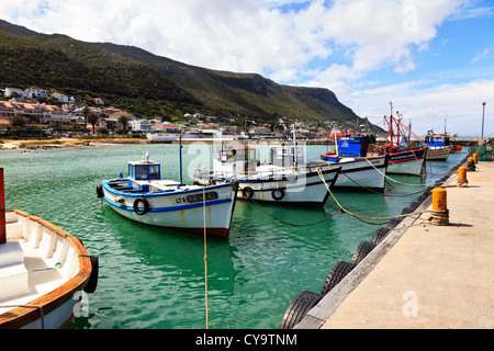 Fishing boats tied up to the quay in the small fishing harbour of Kalk Bay near Cape Town South Africa. - Stock Photo
