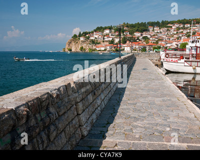 Ohrid lake and harbour view in the popular tourist resort of Ohrid town, Republic of Macedonia. Kaneo visible on - Stock Photo