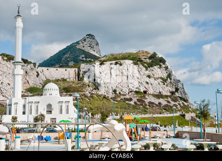 The Rock of Gibraltar seen from its southern tip at Europa Point. Newly-built mosque and children's play area in - Stock Photo