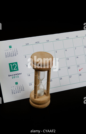 Calendar marked on December 21st 2012 the Mayan Judgment Day with a sand timer - Stock Photo