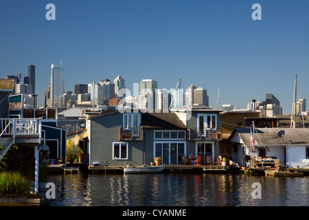 WA04517-00...WASHINGTON - House boat community on Lake Union with the highrises of Seattle in the background. - Stock Photo