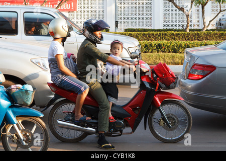 Family on Motorcycle in Vientiane, Laos - Stock Photo