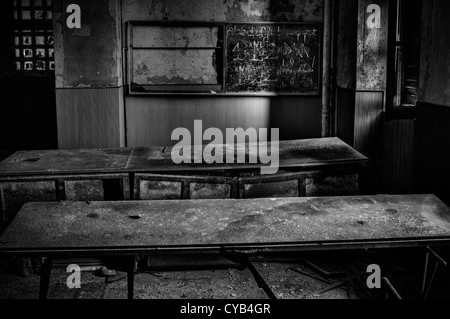 Italy. Ruined classroom in abandoned school - Stock Photo