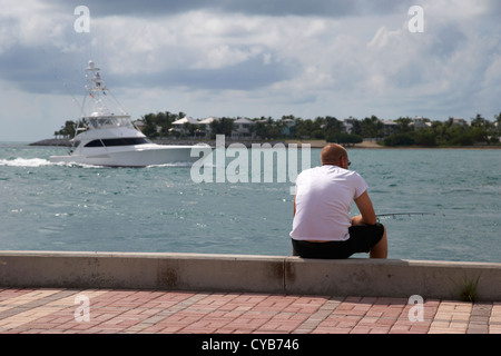 man fishing on mallory square seafront key west florida usa - Stock Photo