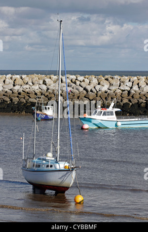 Boats moored behind the brake-water in Rhos on Sea, North Wales. - Stock Photo