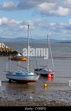 Yachts moored on the beach in Rhos on Sea, North Wales. - Stock Photo