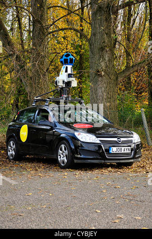 Black Google car with roof mounted camera equipment in car park - Stock Photo