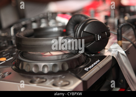 A DJ set showing a set of headphones and decks from the Nottinghill Carnival 2012 - Stock Photo
