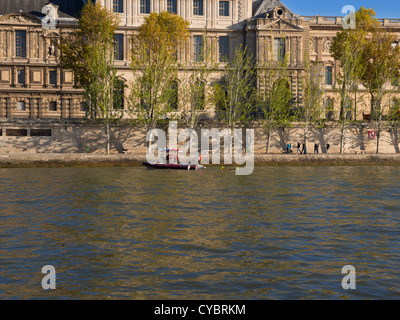 Fire Services rescue boat on the Seine River, Paris. Firemen on a rescue boat practice on the Seine in front of - Stock Photo