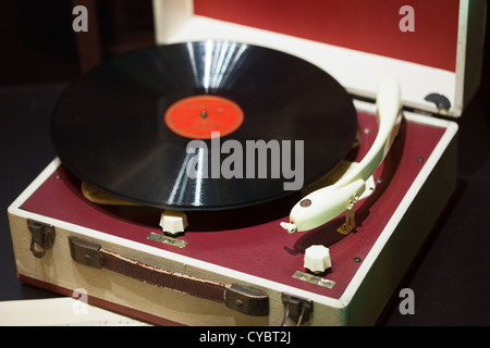 old gramophone player and records in display cabinet on board Queen Victoria Cunard Liner. - Stock Photo