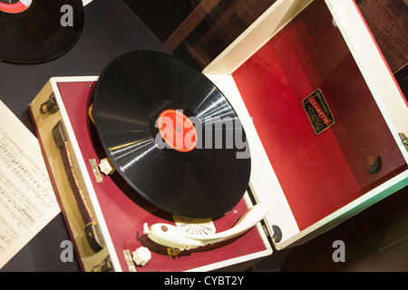 old gramophone player and records and music sheets in display cabinet on board Queen Victoria Cunard Liner. - Stock Photo