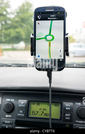 Sat nav gps on a smartphone in a car - Stock Photo