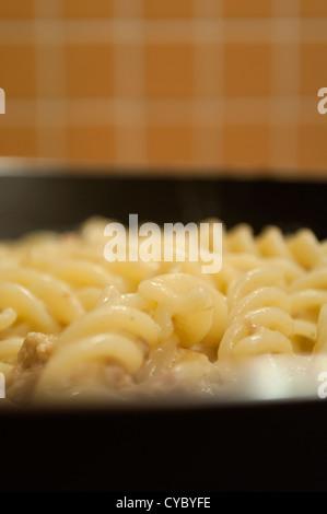 Fusilli pasta in pan - Stock Photo