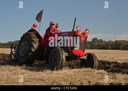 massey ferguson 65 tractor with driver and plough at ploughing match demonstration display show competition - Stock Photo