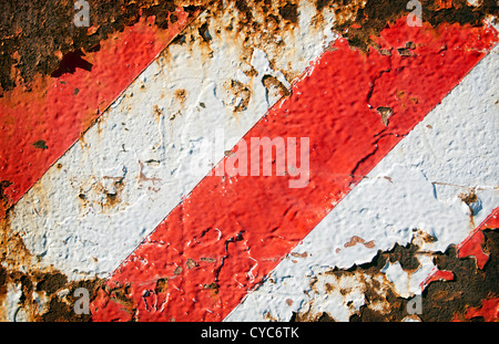 Grunge striped background of rusted metal and red and white painted stripes - Stock Photo