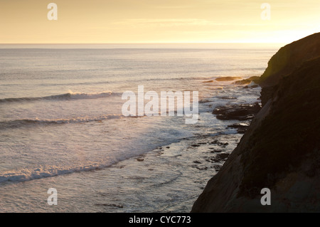 Waves lap at sunset along the Great Ocean Road, Australia - Stock Photo