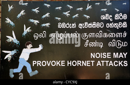 Sign at Sigiriya ancient rock temple warning of hornet attack if noise levels are too high. - Stock Photo