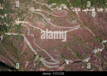 SWITCHBACKS (aerial view). Winding road above the Daluis Gorge on the French Riviera's backcountry, France. - Stock Photo