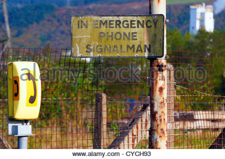 emergency phone signalman telephone at an unmanned railway level crossing in margam port talbot - Stock Photo