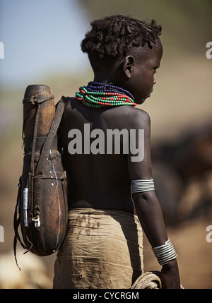 Young tribal boy carrying a calabas. - Stock Photo