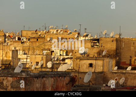 Roof tops of apartment houses with satellite dishes on top in the old quarter medina in the city Casablanca, Morocco. - Stock Photo
