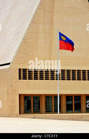 Flag of Liechtenstein before Landtag in capital Vaduz - Stock Photo