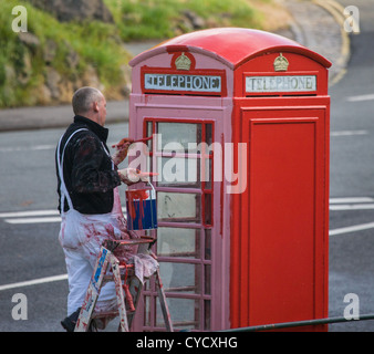 Painting a British listed K6 telephone box in Clifton Bristol UK - Stock Photo