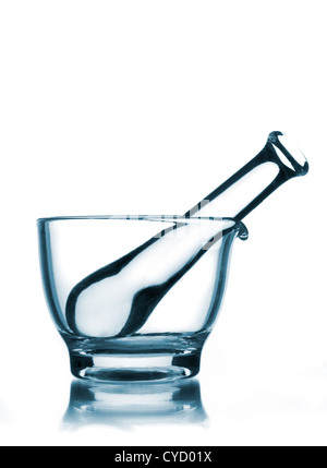 Black and white photograph with blue-tint duotone of glass Mortar and Pestle showing table reflection against white - Stock Photo