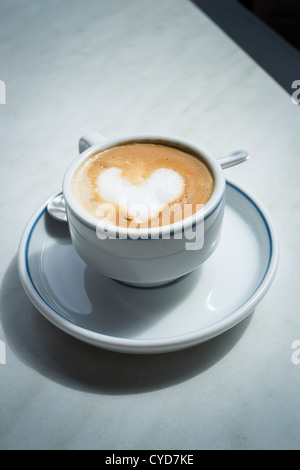 Cafe con leche with heart shape in the frothy milk on top - Stock Photo