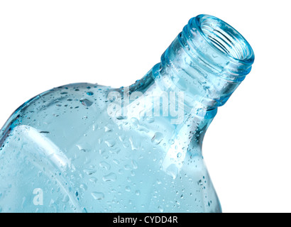 Blue empty bottle with water drops. Closeup, isolated on white - Stock Photo