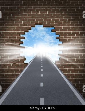 Break through to opportunity concept with a highway going through a broken brick wall to a shinning light of success - Stock Photo