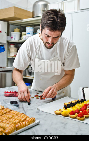 A pastry man at work - Stock Photo