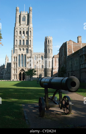 Old cannon in front of West Tower of Ely Cathedral - Stock Photo
