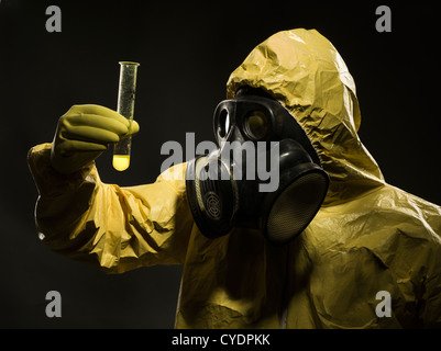 Man with gas mask and hazmat suit - Stock Photo