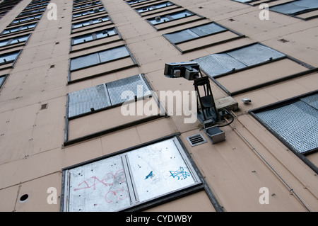Surveillance, CCTV or closed circuit video camera mounted on the wall of Glasgow's notorious Red Road Flats, a high - Stock Photo