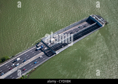 The Netherlands, Amsterdam, Access of Zeeburgertunnel, connecting the south and north of the city. Lake Het IJ. - Stock Photo