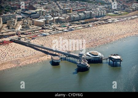 The Netherlands, Scheveningen, The Hague or in Dutch. Events center called De Pier. People sunbathing on the beach. - Stock Photo