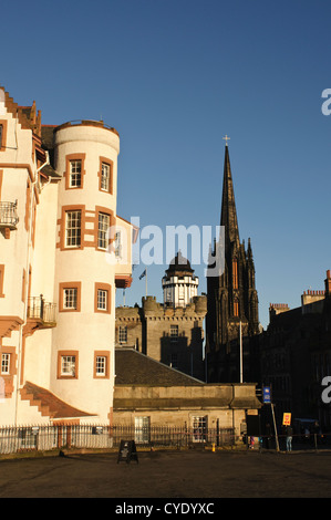 Autumn light on Ramsay Garden, the Camera Obscura and the Hub, viewed from Edinburgh Castle Esplanade. - Stock Photo