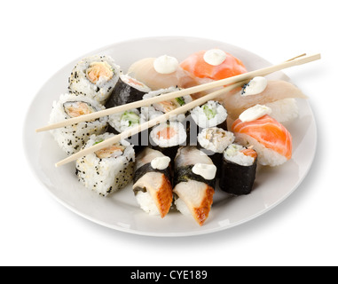 Sushi and rolls in a plate with sticks isolated on a white background. Clipping path - Stock Photo