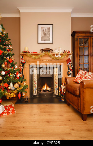 Christmas scene in a living room with copyspace - Stock Photo