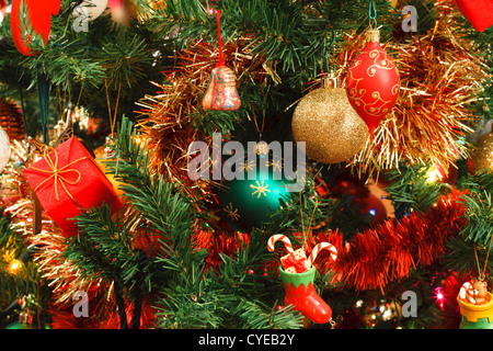 Closeup of Christmas ornaments on artifical tree - Stock Photo