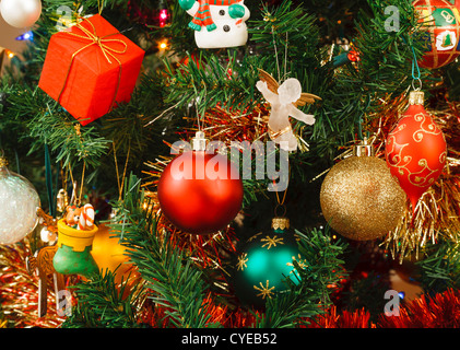 Christmas tree decorated with ornaments and an angel - Stock Photo