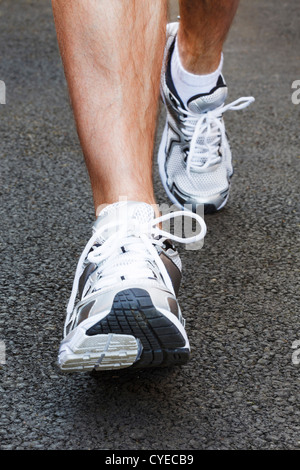 Closeup of running shoes on a jogger - Stock Photo